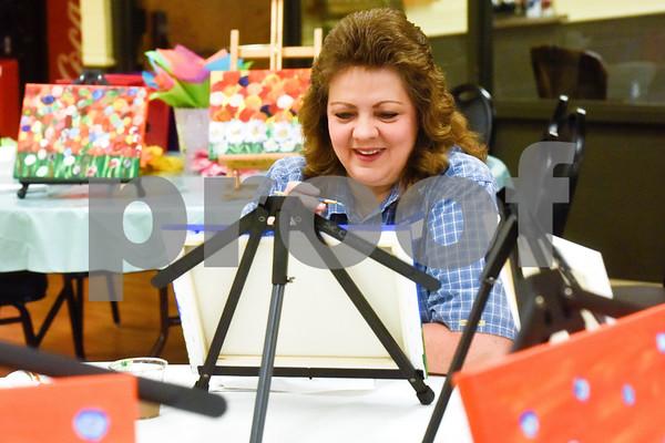 Andrea Jordan smiles as she paints during a painting party at the Tyler Senior Center in Tyler, Texas, on Thursday, Aug. 23, 2018. (Chelsea Purgahn/Tyler Morning Telegraph)
