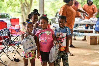 (From left to right) Tazyhia Traylor (4), Kezoryhia Carey (7), Liberti McClelland (5) and Brandon Carey (6) hold up school supplies provided at the Pack the Park event on Saturday, August 24. The event was hosted by the 747 Riders Club at Nichols Green Park in Jacksonville. (Jessica T. Payne/Tyler Morning Telegraph)