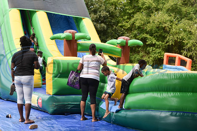 Young children play in a bouncy house at the Pack the Park event on Saturday, August 24. The event was hosted by the 747 Riders Club at Nichols Green Park in Jacksonville. (Jessica T. Payne/Tyler Morning Telegraph)