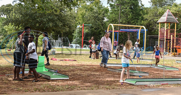 Jacksonville residents gathered at Nichols Green Park on Saturday, August 24 for the Pack the Park event. The event provided free school supplies to local children and also included a hot dog lunch, put-put golf, bouncy houses, games and more. (Jessica T. Payne/Tyler Morning Telegraph)