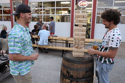 Playing Jenga game at the Downtown Tyler Summer Wrap-Up Party at ETX Brewery.