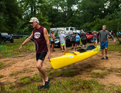 Frank Walker, of Little Rock, Arkansas, helps Wayne Brown, of Palestine, carry his kayak to a spot on the river bank during registration for the 29th annual Neches River Wilderness Race Saturday morning, Aug. 3, 2019, at a starting point in the Lake Palestine dam area on Highway 79 between Jacksonville and Palenstine. The 22-mile river race was put on by the Neches River Runner Paddling Club.  (Cara Campbell/Tyler Morning Telegraph)
