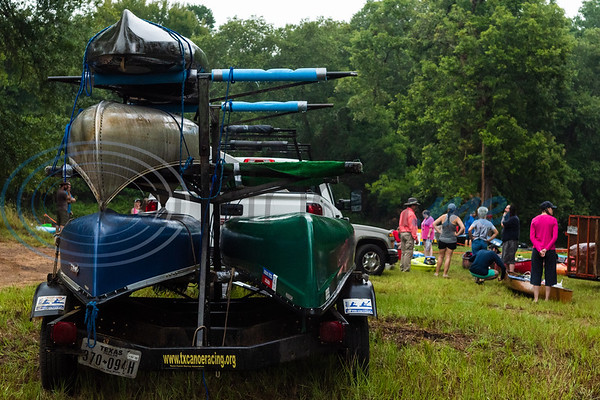 Canoes sit on display while participants register during the 29th annual Neches River Wilderness Race Saturday morning, Aug. 3, 2019, at a starting point in the Lake Palestine dam area on Highway 79 between Jacksonville and Palenstine. The 22-mile river race was put on by the Neches River Runner Paddling Club.  (Cara Campbell/Tyler Morning Telegraph)