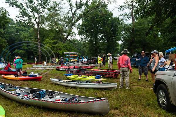Canoes and kayaks, prepped with water, snacks and sunscreen, sit on display as participants register during the 29th annual Neches River Wilderness Race Saturday morning, Aug. 3, 2019, at a starting point in the Lake Palestine dam area on Highway 79 between Jacksonville and Palenstine. The 22-mile river race was put on by the Neches River Runner Paddling Club.  (Cara Campbell/Tyler Morning Telegraph)