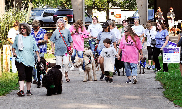 John P. Cleary | The Herald Bulletin<br /> Participants in Madison County's first American Cancer Society Bark For Life  start the walk Saturday morning as a group around Beulah Park in Alexandria.