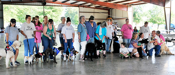 John P. Cleary | The Herald Bulletin<br /> Participants in Madison County's first American Cancer Society Bark For Life event pose for a group photo before starting the walk Saturday.