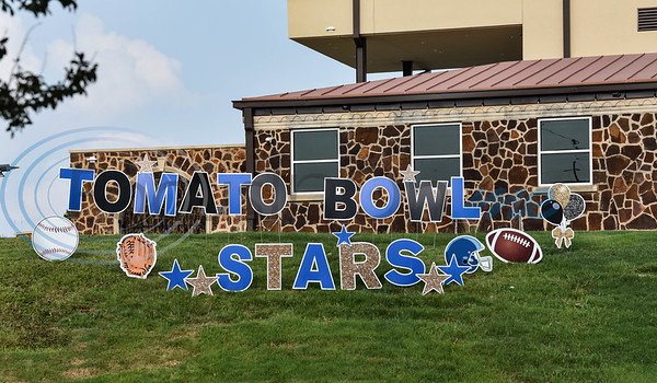 A sign sits at the newly renovated Tomato Bowl welcoming honorees of the 8th annual Evening with Our Stars event put on by the Jacksonville Education Foundation. The event took place at the Norman Activity Center on Monday, August 5. (Jessica T. Payne/Tyler Morning Telegraph)