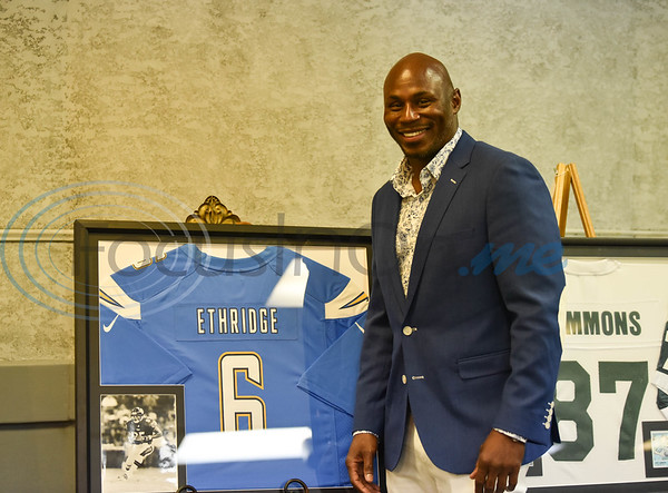 Ray Ethridge, JHS Class of 1987, stands with his jersey at the Evening with Our Stars event hosted by the Jacksonville Education Foundation on Monday, August 8. Ethridge was one of 11 professional football players honored at the event. (Jessica T. Payne/Tyler Morning Telegraph)