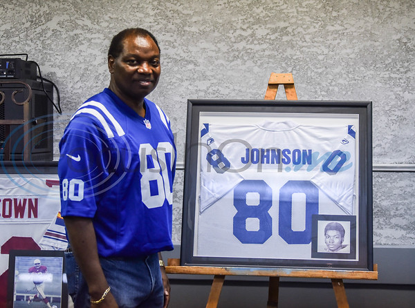 Marshall Johnson, FD/JHS Class of 1971, stands with his jersey at the Evening with Our Stars event hosted by the Jacksonville Education Foundation on Monday, August 8. Ethridge was one of 11 professional football players honored at the event. (Jessica T. Payne/Tyler Morning Telegraph)