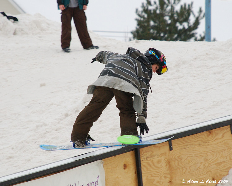 Rail Jam<br /> Trying to catch a frisbee while doing a trick