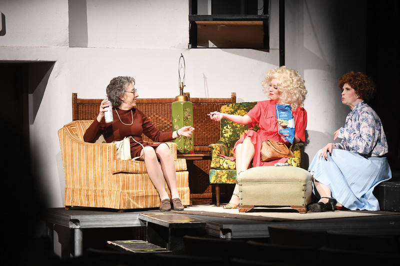"Matthew Gaston | The Sheridan Press<br>After a terrible day at work, from left, Violet Newstead, Doralee Rhodes and Judy Bernly, played by Dawn Sopron, Amanda Patterson and Pollyanna Averett respectively, share a ""marijuana cigarette"" and bond over their mutual disgust of their boss during the dress rehearsal for the WYO Theater and Civic Theatre Guild co-production of ""9 to 5"" Tuesday, March 5, 2019."