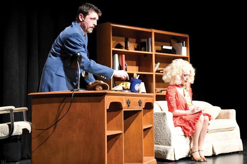 "Matthew Gaston | The Sheridan Press<br>The devious Franklin Hart, played by Dan Cole, knocks over a cup of pencils to lure his unsuspecting personal assistant Doralee Rhodes, played by Amanda Patterson, into a compromising position during the dress rehearsal for ""9 to 5 the Musical"" Tuesday, March 5, 2019."