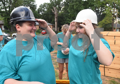 Future homeowner Ashley Shears and her daughter Hailie Shears, 13, put on hard hats so they can help raise the walls of their new home being built through the Smith County Habitat for Humanity 2016 Women's Build Saturday Sept. 10, 2016. The build is sponsored by more than 100 women throughout Smith County.  (Sarah A. Miller/Tyler Morning Telegraph)