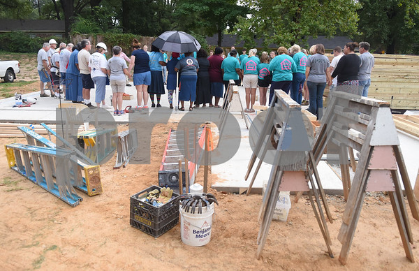 Volunteers pray together before starting construction on a new home for future homeowner Ashley Shears and her daughter Hailie Shears, 13, Saturday Sept. 10, 2016. The Shears' home is being built through the Smith County Habitat for Humanity 2016 Women's Build Saturday Sept. 10, 2016. The build is sponsored by more than 100 women throughout Smith County.  (Sarah A. Miller/Tyler Morning Telegraph)
