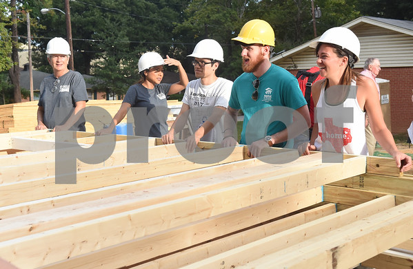 Volunteers move a wall for a new home for future homeowner Ashley Shears and her daughter Hailie Shears, 13, Saturday Sept. 10, 2016. The Shears' home is being built through the Smith County Habitat for Humanity 2016 Women's Build Saturday Sept. 10, 2016. The build is sponsored by more than 100 women throughout Smith County.  (Sarah A. Miller/Tyler Morning Telegraph)