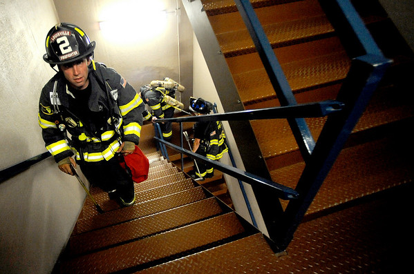 "09012CLIMB6.jpg Eric Williams, with the Louisville Fire Department, trudges up the stairs for the 9/11 Memorial Stair Climb at the Qwest Building in Denver, Colorado September 11, 2009. 343 Firefighter from 5 states climbed the 55 stories of the Qwest building twice for a total of 110 stories in remembrance of the figherfighters killed in the World Trade Center attack September 11, 2001. Watch a video of the 911 memorial climb at  <a href=""http://www.dailycamera.com"">http://www.dailycamera.com</a> CAMERA/Mark Leffingwell"