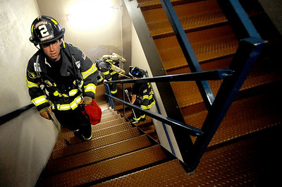 09012CLIMB6.jpg Eric Williams, with the Louisville Fire Department, trudges up the stairs for the 9/11 Memorial Stair Climb at the Qwest Building in Denver, Colorado September 11, 2009. 343 Firefighter from 5 states climbed the 55 stories of the Qwest building twice for a total of 110 stories in remembrance of the figherfighters killed in the World Trade Center attack September 11, 2001. Watch a video of the 911 memorial climb at www.dailycamera.com CAMERA/Mark Leffingwell