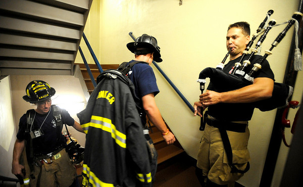 09012CLIMB3.jpg Mike O'Connor (cq) with the Cunningham Fire Department in Denver, plays bagpipes for the firefighter climbing the stairs for the 9/11 Memorial Stair Climb at the Qwest Building in Denver, Colorado September 11, 2009. 343 Firefighter from 5 states climbed the 55 stories of the Qwest building twice for a total of 110 stories in remembrance of the figherfighters killed in the World Trade Center attack September 11, 2001. CAMERA/Mark Leffingwell