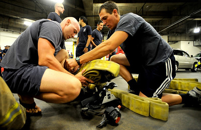 09012CLIMB2.jpg Mike Carnelli (cq)(left) and Matt Cokewell (cq)(right), both with Louisville Fire Department prepare their gear for the 9/11 Memorial Stair Climb at the Qwest Building in Denver, Colorado September 11, 2009. 343 Firefighter from 5 states climbed the 55 stories of the Qwest building twice for a total of 110 stories in remembrance of the figherfighters killed in the World Trade Center attack September 11, 2001. CAMERA/Mark Leffingwell