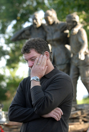Michael Faughnan, looking at the New York monolith, takes a moment to remember his brother Chris, who died in the World Trade Center, after the ceremony at the 9/11 Memorial in Community Park in Broomfield on Friday morning.<br /> <br /> Sept. 11, 2009<br /> Staff photo/David R. Jennings