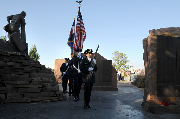 The combined police and fire honor guard bring the colors in for Friday's ceremony at the 9/11 Memorial in Community Park in Broomfield.<br /> <br /> Sept. 11, 2009<br /> Staff photo/David R. Jennings
