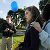 Michael Faughnan, left, with Siena Flaughnan, 15, and Maureen Stines prepare to launch balloons in honor of Chris Faughnan, who died in the World Trade Center attacks, after Friday's ceremony at the 9/11 Memorial in Community Park in Broomfield.<br /> <br /> Sept. 11, 2009<br /> Staff photo/David R. Jennings