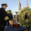 Fire Chief Joe Bruce rings the fire bell after laying a wreath with  Police Chief Tom Deland during the ceremony on Friday at the 9/11 Memorial in Community Park in Broomfield.<br /> <br /> Sept. 11, 2009<br /> Staff photo/David R. Jennings