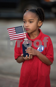 Christian Heritage School student Busisiwe Whitlock, 7, holds an American flag during a program at T.B. Butler Fountain Plaza in downtown Tyler Monday Sept. 11, 2017 to commemorate the terrorist attacks on Sept. 11, 2001.   (Sarah A. Miller/Tyler Morning Telegraph)