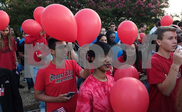 Students from Tyler area schools wait to release in honor of first responders killed during 9/11 during a program at T.B. Butler Fountain Plaza in downtown Tyler Monday Sept. 11, 2017 to commemorate the terrorist attacks on Sept. 11, 2001.   (Sarah A. Miller/Tyler Morning Telegraph)