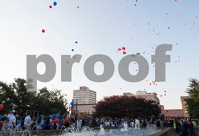 Students from Tyler area schools release in honor of first responders killed during 9/11 during a program at T.B. Butler Fountain Plaza in downtown Tyler Monday Sept. 11, 2017 to commemorate the terrorist attacks on Sept. 11, 2001.   (Sarah A. Miller/Tyler Morning Telegraph)