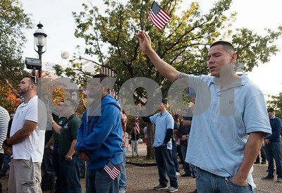 "Bernabe Perez of Tyler holds up his United States flag and sings ""God Bless America"" during a program at T.B. Butler Fountain Plaza in downtown Tyler Monday Sept. 11, 2017 to commemorate the terrorist attacks on Sept. 11, 2001.   (Sarah A. Miller/Tyler Morning Telegraph)"