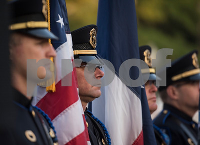 The Tyler Police color guard stands at attention during a program at T.B. Butler Fountain Plaza in downtown Tyler Monday Sept. 11, 2017 to commemorate the terrorist attacks on Sept. 11, 2001.   (Sarah A. Miller/Tyler Morning Telegraph)