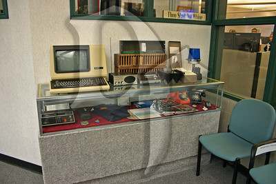Atrium display case containing relics of emergency communications.