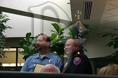 911 Director John Merklinger presents the award for 2010 Emergency Medical Dispatcher (EMD) of the Year to William Leone, Jr.