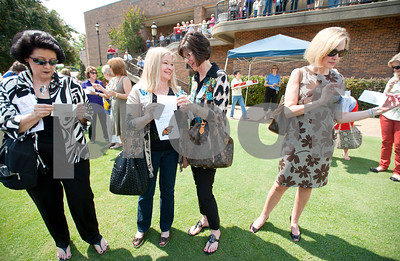 photo by Sarah A. Miller/Tyler Morning Telegraph  Tyler residents Nancy Wrenn, Connie Seale, Mary Ann Dougherty and Holly Carroll wait to release several envelopes of butterflies at the Alzheimer's Alliance's butterfly release event at the Tyler Rose Garden Thursday.  The public was invited to make a donation of 25 dollars each per butterfly.  Over 1,100 butterflies were released to honor and commemorate lives touched by Alzheimer's disease and other dementias in Smith County.