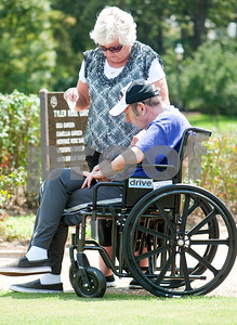 photo by Sarah A. Miller/Tyler Morning Telegraph  Diane and Charles Lee of Hawkins prepare to release a butterfly at the Alzheimer's Alliance's butterfly release event at the Tyler Rose Garden Thursday. Diane Lee released the butterfly in honor of her husband Charles who suffers from severe Alzheimer's disease. The public was invited to make a donation of 25 dollars each per butterfly.  Over 1,100 butterflies were released to honor and commemorate lives touched by Alzheimer's disease and other dementias in Smith County.