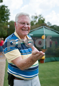 photo by Sarah A. Miller/Tyler Morning Telegraph  A butterfly lands on the hand of Don McClaugherty of Tyler during the Alzheimer's Alliance's butterfly release event at the Tyler Rose Garden Thursday. The public was invited to make a donation of 25 dollars each per butterfly.  Over 1,100 butterflies were released to honor and commemorate lives touched by Alzheimer's disease and other dementias in Smith County.
