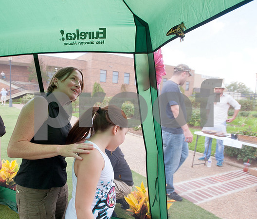 photo by Sarah A. Miller/Tyler Morning Telegraph  Tammie Hughes of Overton and her daughter Katie Hughes, 10, watch butterflies fly inside of a small tent before the start of the Alzheimer's Alliance of Smith County's first ever butterfly release event at the Tyler Rose Garden Thursday.  The public was invited to make a donation of 25 dollars each per butterfly.  Over 1,100 butterflies were released to honor and commemorate lives touched by Alzheimer's disease and other dementias in Smith County.