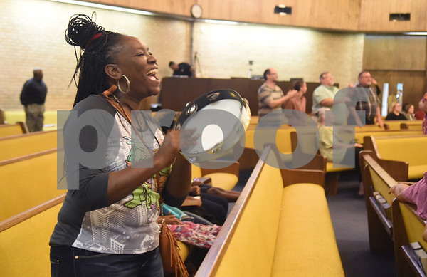 Renay Johnson stands up in the pews to sing as the New Life Community Church choir performs during the Peace and Praise program held at the church Wednesday night Sept. 14, 2016 in Tyler. The event was the kick-off to the annual Art of Peace Tyler festival.  (Sarah A. Miller/Tyler Morning Telegraph)