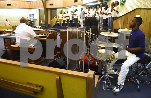 The New Life Community Church choir performs with minister of music Broderick McGee on piano and Darryl Friend on drums during the Peace and Praise program held at the church Wednesday night Sept. 14, 2016 in Tyler. The event was the kick-off to the annual Art of Peace Tyler festival.  (Sarah A. Miller/Tyler Morning Telegraph)