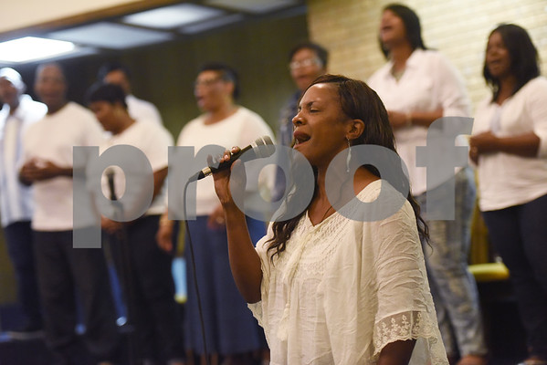 Tabbotha McGee performs a solo with The New Life Community Church choir during the Peace and Praise program held at the church Wednesday night Sept. 14, 2016 in Tyler. The event was the kick-off to the annual Art of Peace Tyler festival.  (Sarah A. Miller/Tyler Morning Telegraph)
