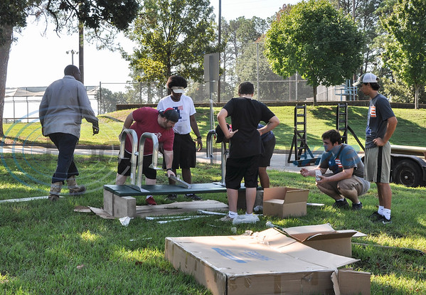 Volunteers work on putting park picnic tables together during Park Service Day. The event, which took place at Fun Forest Park on Saturday, September 15, was hosted by the city of Tyler's initiative Keep Tyler Beautiful. (Jessica T. Payne/Tyler Paper)