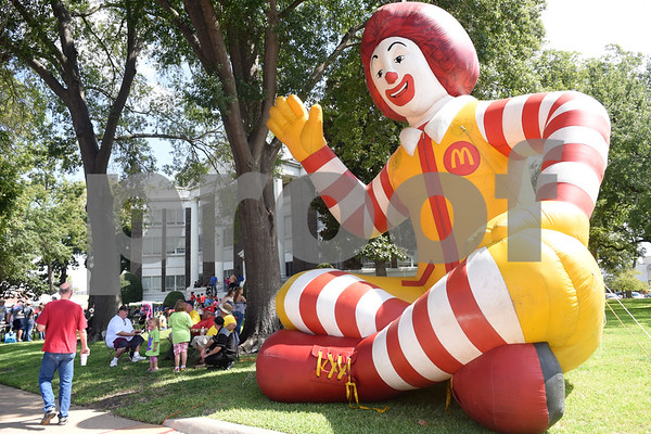 A large inflatable Ronald McDonald greets visitors to the Uncle Fletch Davis Hamburger Festival on the courthouse square in downtown Athens Sept. 26, 2015. Athens claims that Uncle Fletch Davis invented the hamburger and shared his invention at the 1904 St. Louis World's Fair.   (Sarah A. Miller/Tyler Morning Telegraph)