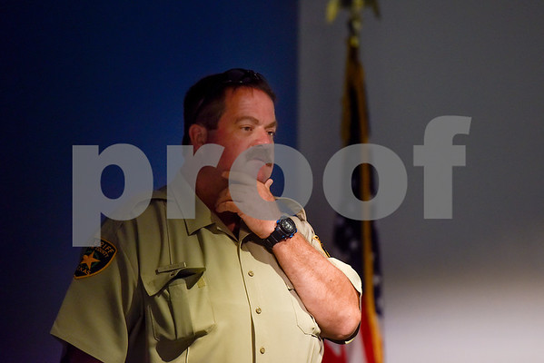 Deputy David Biggs listens during a Tyler Together Race Relations Forum meeting at Tyler Public Library in Tyler, Texas, on Tuesday, Sept. 19, 2017. Ways law enforcement address mental health was discussed during the event. (Chelsea Purgahn/Tyler Morning Telegraph)