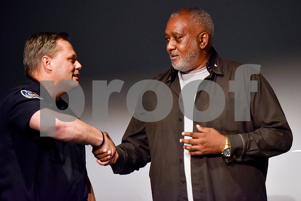 Chief of Police Jimmy Toler shakes hands with Kenneth Cobb during a Tyler Together Race Relations Forum meeting at Tyler Public Library in Tyler, Texas, on Tuesday, Sept. 19, 2017. Ways law enforcement address mental health was discussed during the event. (Chelsea Purgahn/Tyler Morning Telegraph)