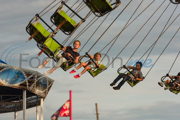 Children ride the YoYo swings during opening day of the East Texas State Fair Friday, Sept. 20, 2019, in Tyler. (Cara Campbell/Tyler Morning Telegraph)