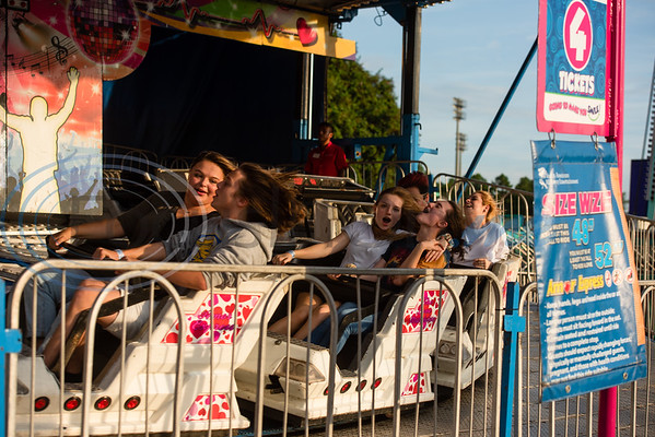 Tylerites laugh and scream as they're whipped around in circles on the Amory Express during opening day of the East Texas State Fair Friday, Sept. 20, 2019, in Tyler. (Cara Campbell/Tyler Morning Telegraph)