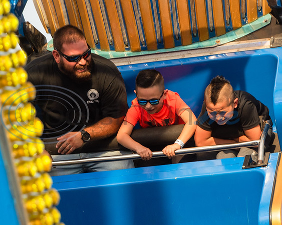 Israel Suarez, (left), Ryan Suarez, 6, and Joseph Lopez, 9, ride Pharaoh's Fury together during opening day of the East Texas State Fair Friday, Sept. 20, 2019, in Tyler. (Cara Campbell/Tyler Morning Telegraph)