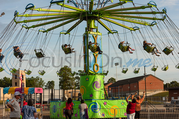 Parents look on as their children ride the YoYo swings during opening day of the East Texas State Fair Friday, Sept. 20, 2019, in Tyler. (Cara Campbell/Tyler Morning Telegraph)