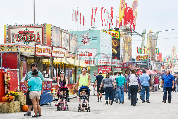 People walk by concessions at the East Texas State Fair in Tyler, Texas, on Friday, Sept. 21, 2018. (Chelsea Purgahn/Tyler Morning Telegraph)